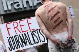 Reporters Without Borders (Reporters Sans Frontieres- RSF) activists take part in a protest in front of an Iran Air agency in…