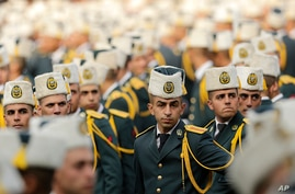 Lebanese officers attend a graduation ceremony marking the 74th Army Day, at a military barracks in Beirut's suburb of…
