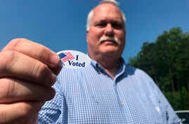 Voter Sandy Blackwell, speaks to a reporter after voting in Mint Hill, N.C. on Tuesday, Sept. 10, 2019. Blackwell, an…