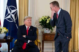White House chief of staff Mick Mulvaney talks with US President Donald after his meeting with NATO Secretary General Jens Stoltenberg at Winfield House, Dec. 3, 2019, in London.