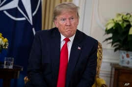 U.S. President Donald Trump speaks during a meeting with NATO Secretary General, Jens Stoltenberg at Winfield House in London,…
