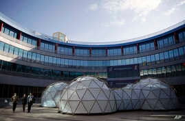 A pollution pod by British artist Michael Pinsky is displayed at the COP25 climate talks summit in Madrid, Spain, Tuesday, Dec…