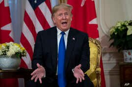 President Donald Trump speaks during a meeting with Canadian Prime Minister Justin Trudeau at Winfield House