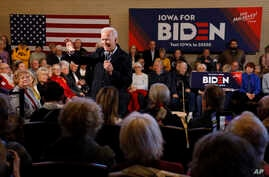 Democratic presidential candidate former Vice President Joe Biden speaks to local residents during a bus tour stop