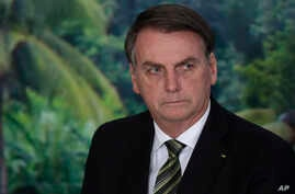FILE - In this Oct. 1, 2019 file photo, President Jair Bolsonaro attends a ceremony to launch an agro program at the Planalto…