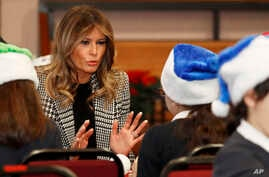 First lady Melania Trump joins local school students creating holiday decorations at the Salvation Army Clapton Center in…