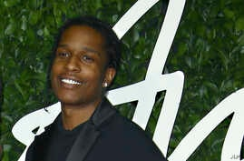 FILE - In this file photo dated Monday, Dec. 2, 2019, ASAP Rocky poses for photographers upon arrival at the British Fashion…