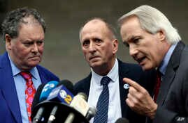 British cave explorer Vernon Unsworth, center, with his attorneys, Mark Stephens, left, and Lin Wood, take questions from the…