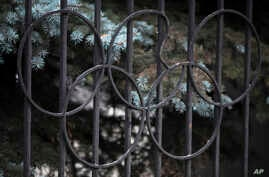 A damaged Olympic ring on the gate of the Russian Olympic Committee