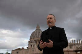 Monsignor John Kennedy, the head of the Congregation for the Doctrine of the Faith discipline section, speaks during an interview on the terrace of the section's offices at the Vatican, Dec. 9, 2019.