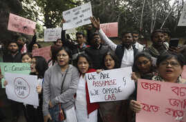 People from northeastern Indian states shout slogans against the government during a protest against Citizenship Amendment Bill (CAB), in New Delhi, India, Dec. 11, 2019.