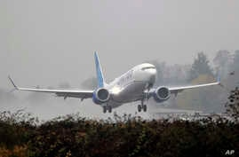 A United Airlines Boeing 737 Max airplane takes off in the rain, Wednesday, Dec. 11, 2019, at Renton Municipal Airport in…