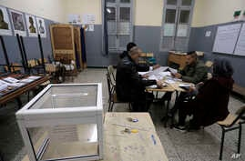 Polling station worker count ballots at a polling station Thursday Dec.12, 2019 in Algiers. Algerians — without a leader since…