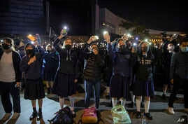 "Protesters wave their smartphones as they sing ""Glory to Hong Kong"" during a rally for secondary school students near the Hong Kong Museum of Art in Hong Kong, Dec. 13, 2019."