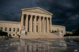FILE - In this June 20, 2019 file photo, The Supreme Court is seen under stormy skies in Washington. The Supreme Court says it…