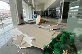 In this photo provided by the Philippine Red Cross, a Christmas tree and other debris lie on the ground inside a building after a strong earthquake shook Digos, Davao del Sur province, southern Philippines, Dec. 15, 2019.
