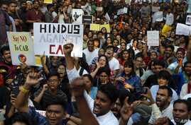 Indians protest against a new citizenship law in Mumbai, India, Monday, Dec. 16, 2019. The new law gives citizenship to non…