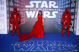 """Actress Kelly Marie Tran poses for photographers upon arrival at the premiere for the film """"Star Wars: The Rise of Skywalker,"""" in central London, Dec. 18, 2019."""