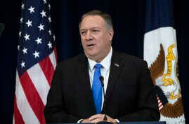 Secretary of State Mike Pompeo delivers remarks on human rights in Iran at the State Department in Washington, Thursday, Dec…