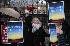 Pro Brexit demonstrators celebrate outside Parliament in London, Friday, Dec. 20, 2019. Members of the British parliament on…