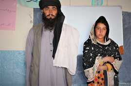 Mia Khan standing next to his daughter, Rozai. (Courtesy: Swedish Committee for Afghanistan)