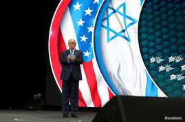 U.S. President Donald Trump bids farewell to the audience after delivering remarks at the Israeli American Council summit