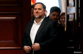 FILE PHOTO: Jailed Catalan politician Oriol Junqueras leaves after getting his parliamentary credentials at Spanish Parliament,…