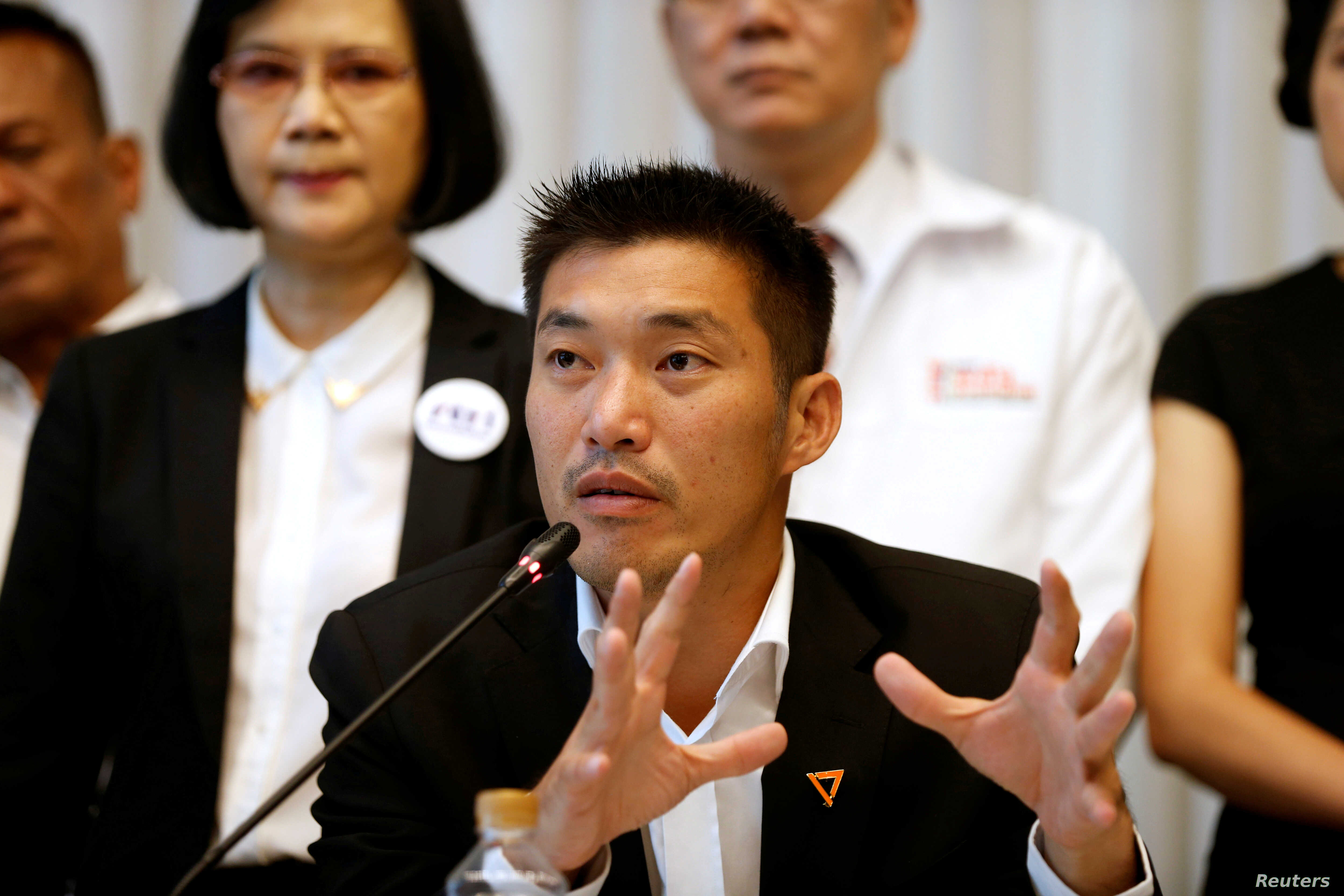 """FILE - Thanathorn Juangroongruangkit, leader of the Future Forward Party talk during a news conference to form a """"democratic front"""" in Bangkok, Thailand, March 27, 2019."""