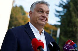 FILE PHOTO: Hungarian Prime Minister Viktor Orban talks to the media after casting his ballot during Hungary's local elections…