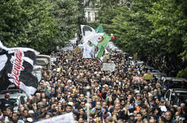 People are seen gathered for a mass anti-government protest in the center of the Algerian capital Algiers, Dec. 17, 2019.