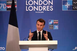 French President Emmanuel Macron speaks during a media conference at the conclusion of a NATO leaders meeting at The Grove hotel and resort in Watford, Hertfordshire, England, Dec. 4, 2019.