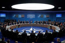 Officials participate in a roundtable meeting during a NATO leaders summmit at The Grove hotel and resort in Watford, England, Wed. Dec. 4, 2019.