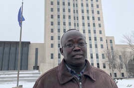 Reuben Panchol is shown Dec. 6, 2019, at the North Dakota state capitol in Bismarck. Panchol, who immigrated from Sudan to North Dakota as a child, says he hopes to tell his personal story at a meeting Monday, Dec. 9.