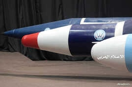 FILE - Missiles are seen on display at an unidentified location in Yemen in this undated handout photo released by the Houthi Media Office, Sept. 17, 2019. The U.S. reportedly seized some suspected Iranian guided missile parts headed to the rebel group.