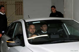 Melvin Theuma, who allegedly acted as a middleman in a plot to murder of journalist Daphne Caruana Galizia, is seen in a police car as he leaves the Courts of Justice in Valletta, Malta, Dec. 4, 2019.
