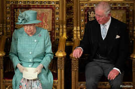 Britain's Queen Elizabeth II sits on the Sovereign's Throne next to Prince Charles during the State Opening of Parliament at the Palace of Westminster in London, Britain, Dec. 19, 2019.