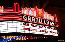 FILE - The marquee of the Grand Lake Theater is seen during the opening of the final chapter of the Skywalker saga 'Star Wars: The Rise of Skywalker' in Oakland, California, Dec. 19, 2019.