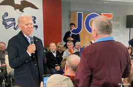 Democratic 2020 U.S. presidential candidate and former U.S. Vice President Joe Biden faces off with a local resident challenging him about his son's involvement with Ukraine in a video screengrab during a campaign event in New Hampton, Iowa, Dec. 5, 2019.