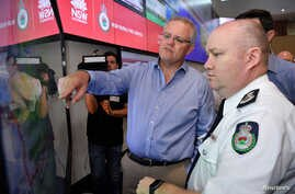 Australia's Prime Minister Scott Morrison is briefed by NSW RFS Commissioner Shane Fitzsimmons in the NSW Rural Fire Service control room in Sydney, Dec. 22, 2019.