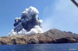 Smoke from the volcanic eruption of Whakaari, also known as White Island, is pictured from a boat, New Zealand, Dec. 9, 2019 in this picture grab obtained from a social media video.