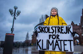 "FILE - Swedish girl Greta Thunberg, 15, holds a placard reading ""School strike for the climate"" during a manifestation against climate change outside the Swedish parliament in Stockholm, Sweden, Nov. 30, 2018."