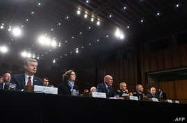 Christopher Wray (L), director of the Federal Bureau of Investigation (FBI), Gina Haspel (2nd R), director of the Central…