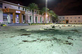 Damage on the concreate, from an air strike earlier in the day, is seen at a Military College in Al-Hadaba region in the…