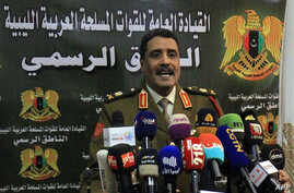Ahmad al-Mesmari, spokesman for Haftar's forces, addresses the media in the eastern Libyan city of Benghazi on January 6, 2020…