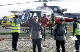 Trekkers arrive after a rescue operation from the Annapurna circuit, at the airport of Pokhara, some 200 km west of Kathmandu,…