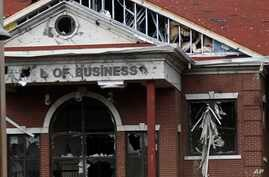 FILE - This Jan. 21, 2017 file photo shows damage to the front of The William Carey University's School of Business after a…