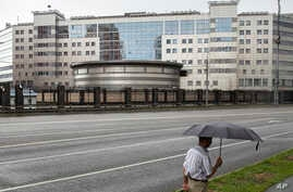 FILE -A man walks past the building of the Main Directorate of the General Staff of the Armed Forces of Russia.