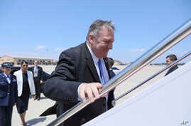 Secretary of State Mike Pompeo boards a plane at Andrews Air Force Base, Md., Tuesday, July 30, 2019.