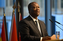 """Ivory Coast's President Alassane Ouattara addresses participants of the """"G20 Investment Summit - German Business and the CwA…"""