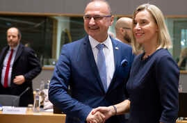 European Union foreign policy chief Federica Mogherini, right, shakes hands with Croatia's Minister for Development Gordan…